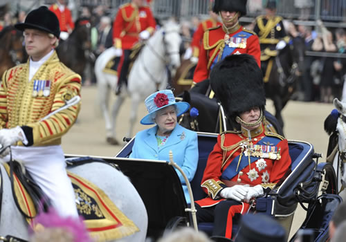 The Queen and Prince Phillip riding their carriage to the parade